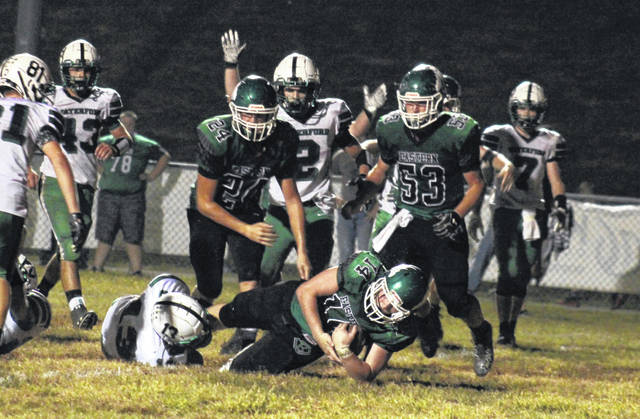 Eastern junior Steve Fitzgerald (14) plunges into the end zone for his second touchdown, during the Eagles' 24-19 setback to Waterford on Friday in Tuppers Plains, Ohio.