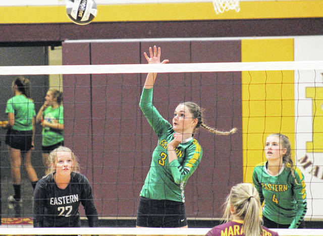 Eastern's Kylie Gheen (3) hits the ball over the net in front of teammates Sydney Sanders (22) and Jenna Chadwell (4), during the Lady Eagles' win over Meigs on Aug. 22 in Rocksprings, Ohio.