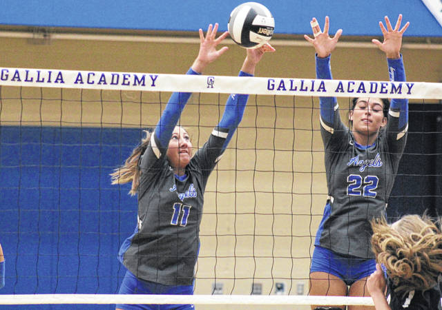 Blue Angels Abby Hammons (11) and Maddie Wright (22) team up for a block, during Gallia Academy's sweep of Coal Grove on Thursday in Centenary, Ohio.