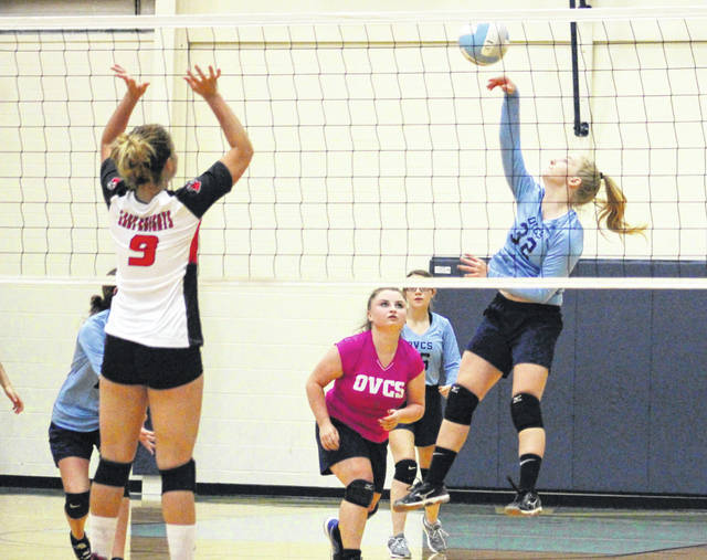 Ohio Valley Christian junior Lauren Ragan, right, hits a spike attempt during Game 2 of Tuesday night's volleyball match against Point Pleasant in Gallipolis, Ohio.