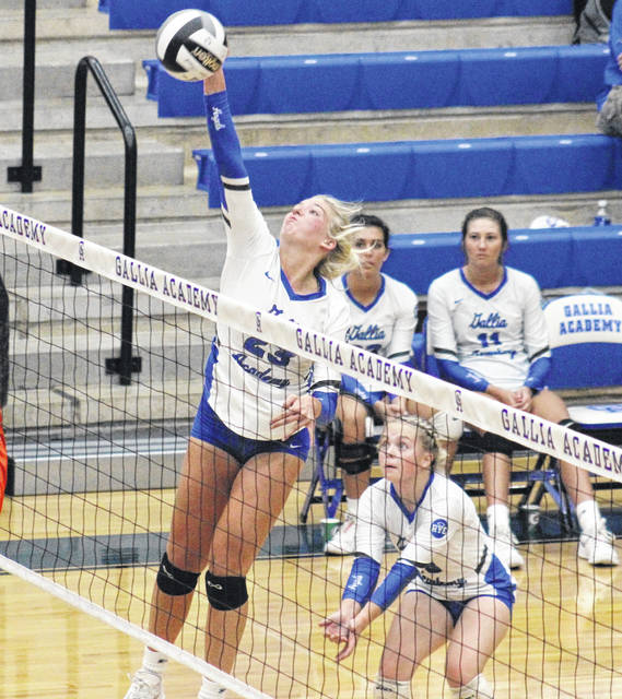 Gallia Academy junior Maddy Petro (left) slams down a spike in front of teammate MaKenna Caldwell, during the Blue Angels' sweep of Ironton on Thursday in Centenary, Ohio.
