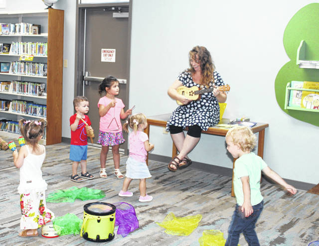 Young library attendees take part in Wiggle Giggle Read at the Meigs County District Public Library.
