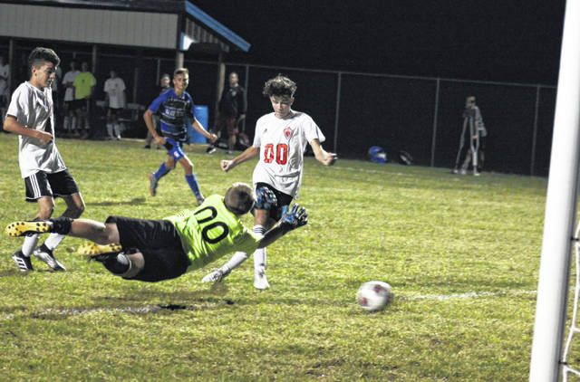 Point Pleasant junior Braxton Watkins-Lovejoy (right) scores the go-ahead goal, during the Black Knights' 2-1 victory on Tuesday in Centenary, Ohio.