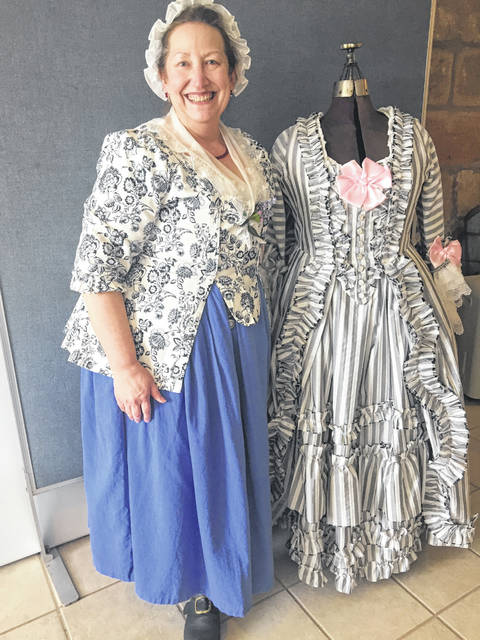 Janet VanMeter is pictured wearing an authentic Colonial dress that she hand made.