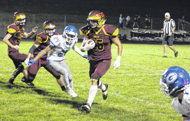 Meigs senior Landon Acree (center) carries the ball for a gain during the Marauders' 24-0 loss to Gallia Academy on Friday in Rocksprings, Ohio.