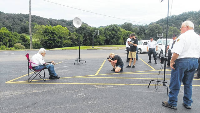 Photos for the calendar, as well as head shot photos of the individual firefighters, were recently taken by Bartee Photography. They are pictured here taking the photo of Bob Wood who has 58 years of service as a volunteer firefighter.