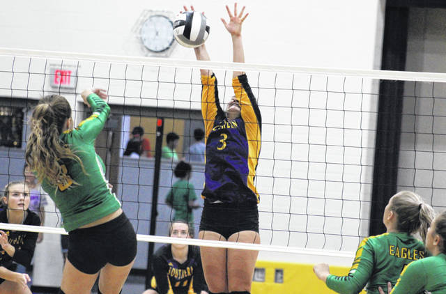 Southern senior Baylee Wolfe (center) blocks an EHS spike attempt, during the Lady Tornadoes' 3-1 victory over Eastern on Thursday in Racine, Ohio.