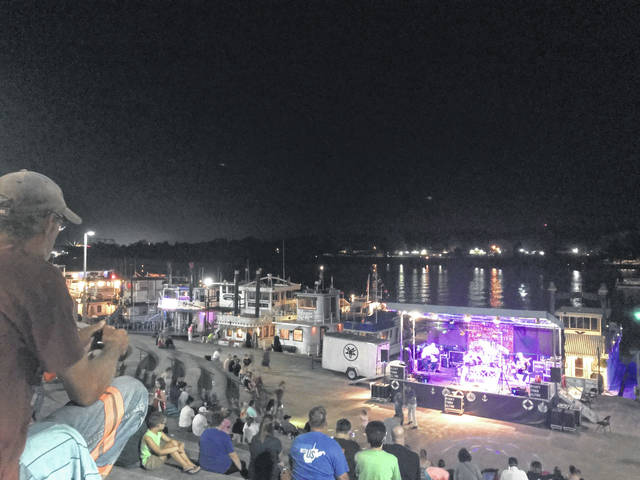 Saturday night, the band Right Turn Clyde, from Cincinnati, Ohio, entertains festival goers at Tribute to the River in Point Pleasant.