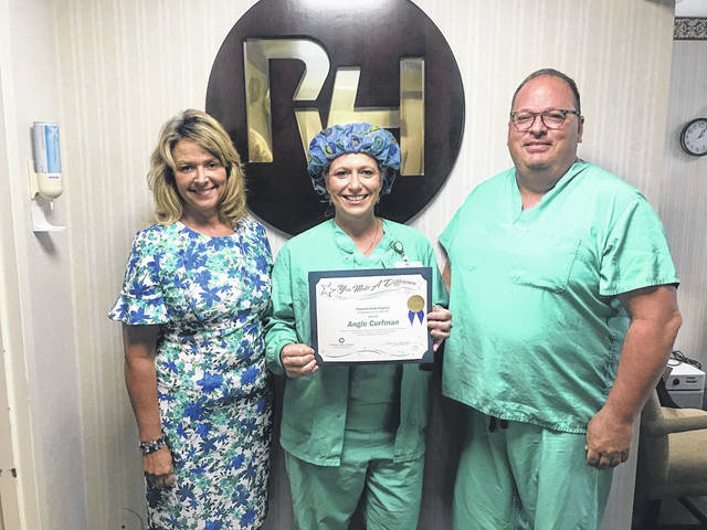 Angie Curfman, at center, is pictured with Connie Davis, former PVH interim CEO and current executive director of Ancillary Services, and Ryan Henry, chief of anesthesia and director of surgical services.