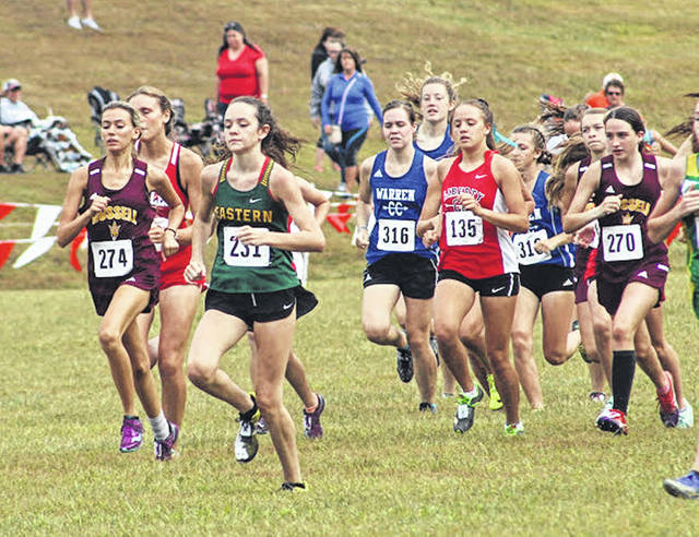 Eastern freshman Erica Durst (231) sprints out ahead of a pack of runners during the varsity girls race Saturday at the 2019 Patty Forgey Invitational held in Rio Grande, Ohio.