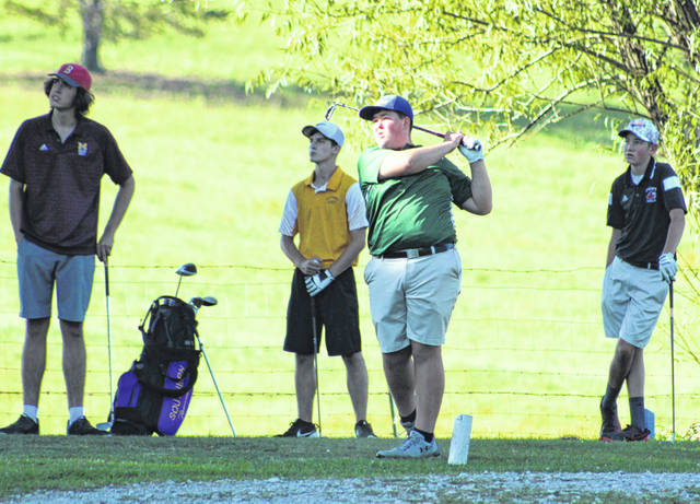 Eastern sophomore Ethan Short watches a tee shot on the ninth hole during an Aug. 29 match at Meigs Golf Course in Pomeroy, Ohio.