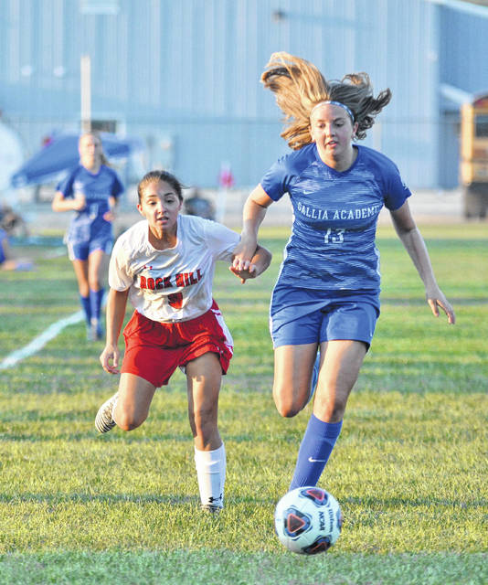 Gallia Academy junior Kaylie Clark (13) chases down a loose ball during Thursday night's OVC girls soccer match against Rock Hill in Centenary, Ohio.