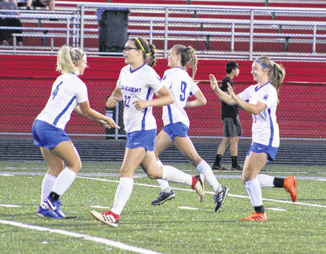 Gallia Academy sophomore Kyrsten Sanders, right, celebrates a goal with teammates Megan Bailey, Preslee Reed and Alivia Lear during the first half of Wednesday night's non-conference girls soccer match against Piketon in Piketon, Ohio.