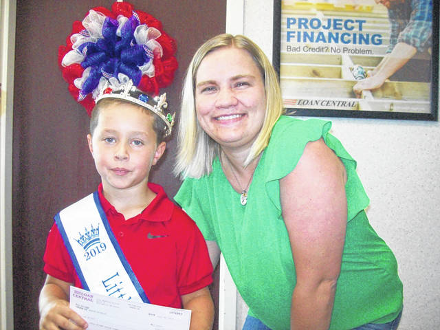 Pictured are Loan Central employee Jasmine McClanahan with Little Mister Hunter Browning.