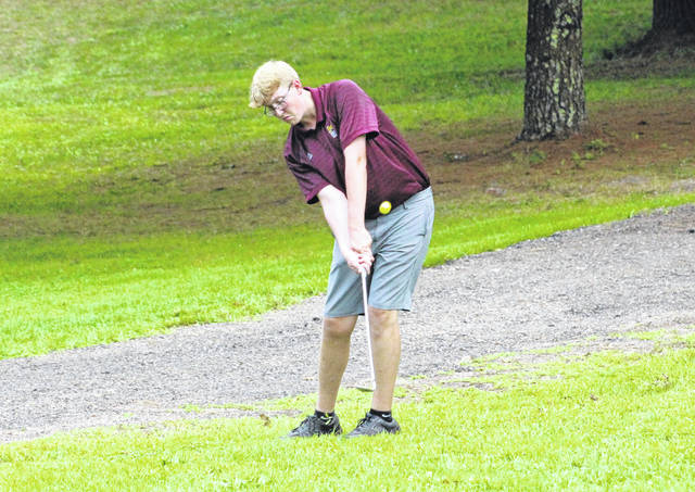 Meigs senior Dawson Justice hits a chip shot during an Aug. 27 match at Meigs Golf Course in Pomeroy, Ohio.