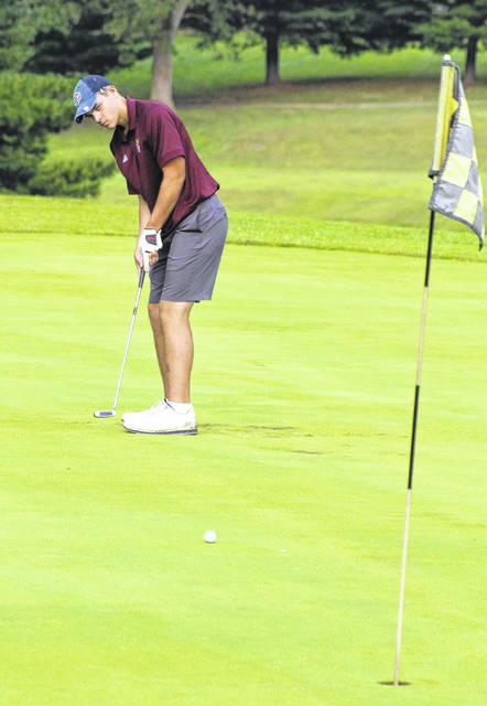Meigs senior Gus Kennedy hits a putt during an August 27 match at Meigs Golf Course in Pomeroy, Ohio.