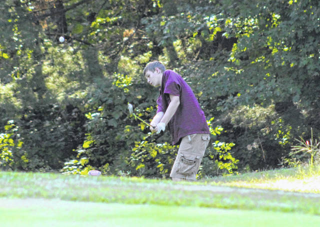 Meigs freshman Zack King hits a chip shot during an August 27 match at Meigs Golf Course in Pomeroy, Ohio.