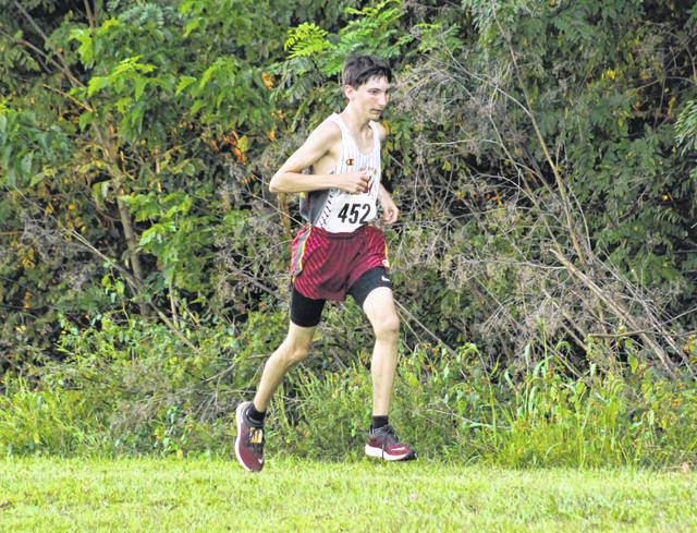 Meigs junior Jarod Koenig hits full stride during the boys varsity race held Wednesday at the 2019 Skyline Lanes Invitational held in Bidwell, Ohio.