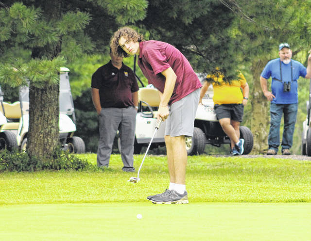 Meigs senior Bobby Musser hits a putt attempt on the ninth hole of an Aug. 27 match at Meigs Golf Course in Pomeroy, Ohio.