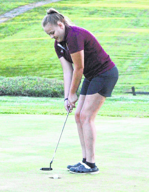 Meigs junior Kylee Robinson sinks a putt during an August 29 match at Meigs Golf Course in Pomeroy, Ohio.