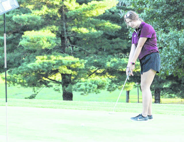 Meigs junior Shelby Whaley hits a putt attempt during an Aug. 29 golf match against Vinton County at Meigs Golf Course in Pomeroy, Ohio.