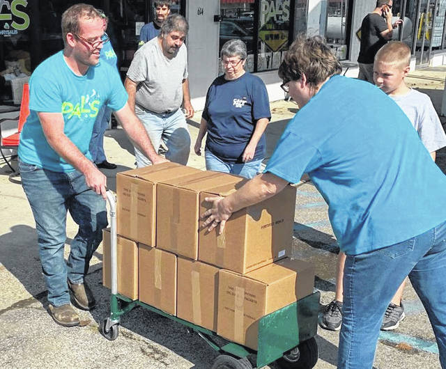 Gallia PALS supporters and area volunteers move food supplies for the 2019 Gallia Hunger Challenge.