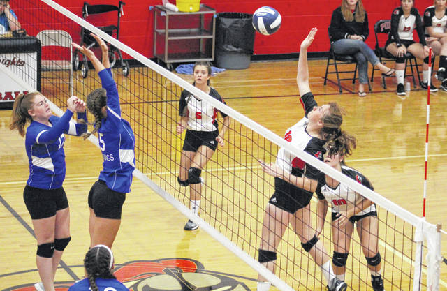 Point Pleasant sophomore Addy Cottrill (18) hits a spike attempt during Game 2 of Thursday night's match against Ripley in Point Pleasant, W.Va.