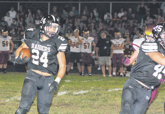 River Valley senior Cole Young (24) runs the ball during Friday night's TVC Ohio football contest against Meigs in Bidwell, Ohio.