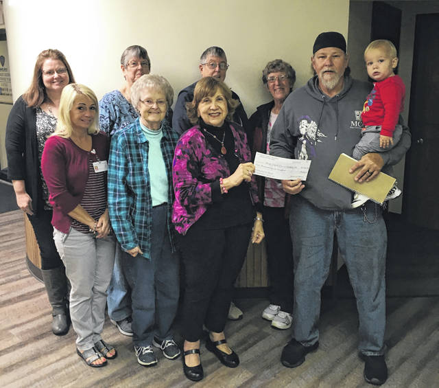 Lee Morris presented a donation to MCCI during their meeting on Monday from funds raised through the annual Ann Morris Cancer Awareness Poker Run. Pictured are (front, from left) Penny Farnese, SEOBCCP; Carolyn Grueser, MCCI Treasurer; Norma Torres, MCCI Chair; Lee Morris and grandson Kashton Nichols; (back, from left) Courtney Midkiff, MCCI Secretary; Lenora Leifheit; Louise Michael; and Wilma Mansfield, MD.