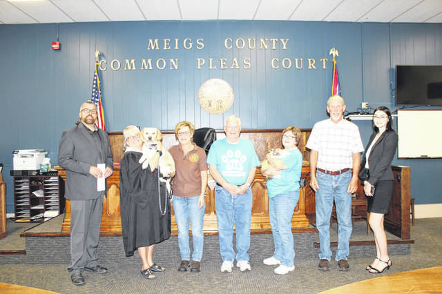 Shelter animals were named the official Meigs County Pet during last week's commissioner meeting. Two rescue animals were in attendance for the resolution. Pictured (from left) are Commissioner Randy Smith, Judge Linda Warner holding Senna, Dog Warden Colleen MurphySmith, John Musser, Dixie Sayre holding PK, Commissioner Tim Ihle and Meigs Senior Kassandra Coleman who was job shadowing clerk Betsy Entsminger during the meeting.