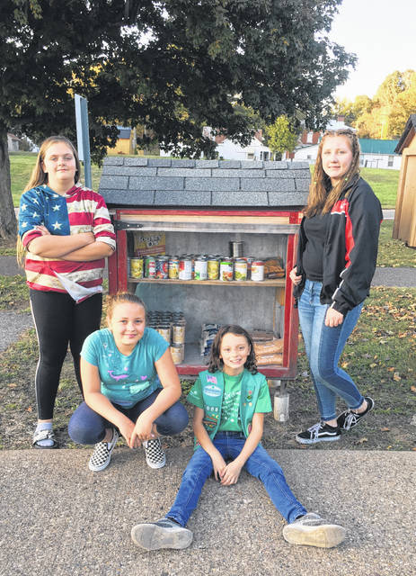 Girl Scouts from Troop 1006 recently completed their September service project, collecting non-perishable food items and distributing the items in the Blessing Boxes around the area. Each month the troop selects a new service project. Pictured are Missouri Brown, Auna Parker, Gracie Barton and Haylee Stout filling the Blessing Boxes.