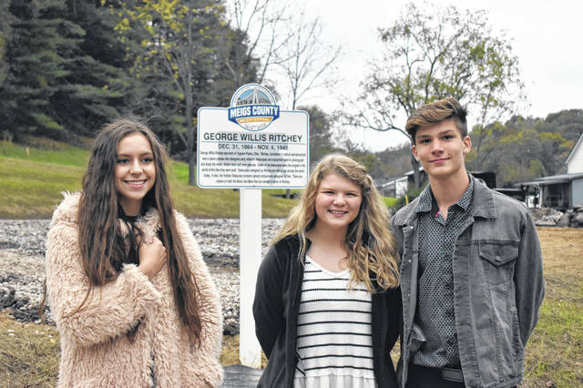 Bicentennial Ambassadors Mattison Finlaw, Brielle Newland and Cooper Schagel are pictured at the Bicentennial Marker unveiling in Orange Township.