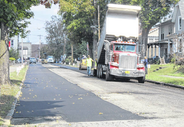 The long awaited paving in portions of Middleport began on Tuesday morning. Paving will be taking place this week in approximately 60 percent of the areas impacted by Phase 2 of the sewer project in the village, according to Village Administrator Joe Woodall. Other areas will be paved following completion of the project. Woodall and Mayor Sandy Iannarelli explained that paving is taking place in areas including South Second and South Third Avenues, with bricks to be replaced in portions of Lincoln Street. Woodall said that the contractor is under a written requirement to replace the bricks that have been disturbed by the project. Paving is expected to take place throughout the week.