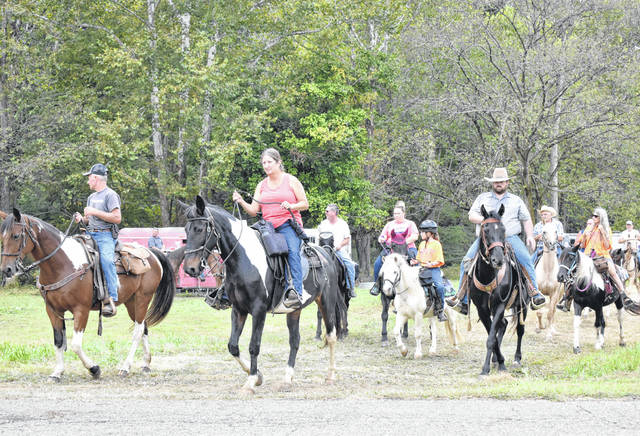 Horses and riders head out onto the trail for the 24th annual St. Jude Trail Ride at the Dill Farm.