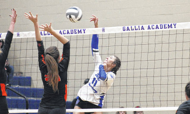 Gallia Academy's Abby Hammons (11) attempts a spike, during the Division II sectional championship on Saturday in Centenary, Ohio.