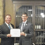 Local banker receives banking diploma from the OBL