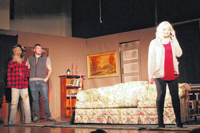 Nathan Becker (Mike) is pictured beside the straw scarecrow during rehearsal. Pictured in front is Sara Michael (Maxine Jackson).