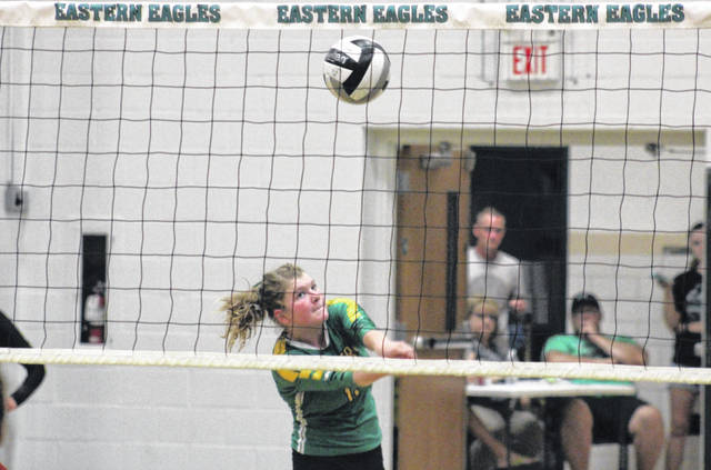 Eastern sophomore Brielle Newland sends the ball over the net, during the Lady Eagles straight games victory on Tuesday in Tuppers Plains, Ohio.