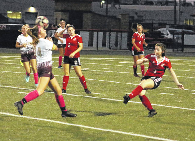 Point Pleasant senior Lacie Mullins (3) clears a loose ball out of the Williamstown attack zone during the first half of Tuesday night's girls soccer match at OVB Field in Point Pleasant, W.Va.