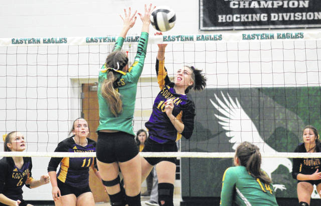 SHS junior Jordan Hardwick (10) spikes the ball past the block of EHS junior Kylie Gheen, during the Lady Tornadoes' 3-0 victory on Thursday in Tuppers Plains, Ohio.