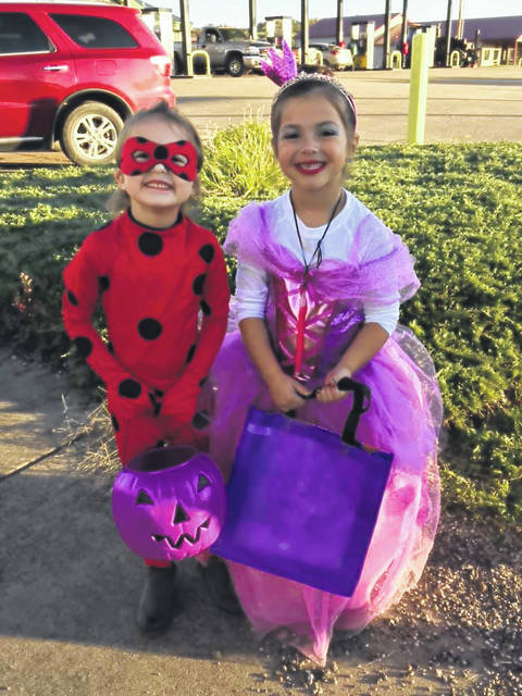 Spencer King and Brooklyn Keaton trick-or-treat in Tuppers Plains.