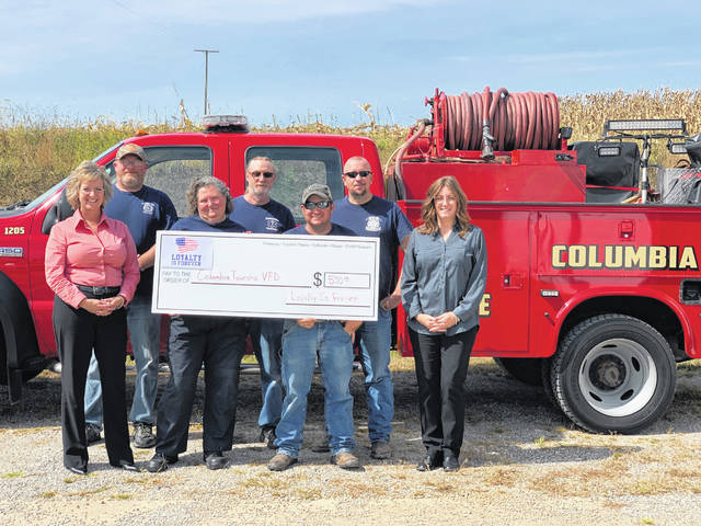 Representatives from the Columbia Township Volunteer Fire Department were recently presented a check from Loyalty is Forever as the winner of the Facebook like and share contest.