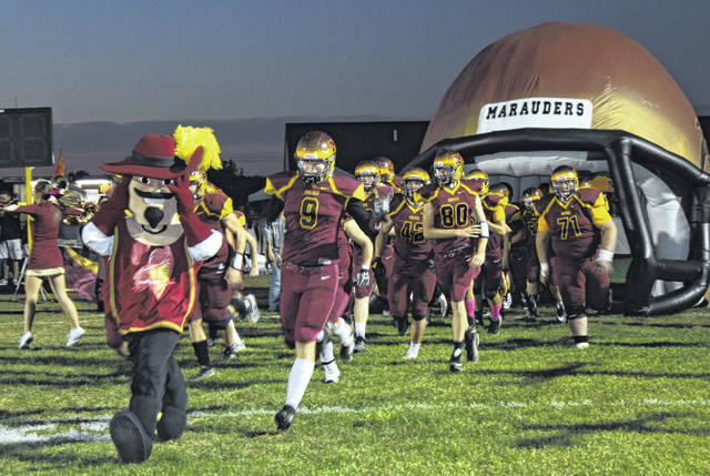 The Meigs Marauders take to the field to begin Friday evening's Homecoming game.