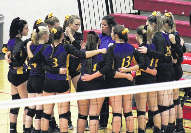 Fourth-year Southern head coach Kim Hupp talks with her team, during a break in the action in the Division IV district semifinal on Oct. 24 in Jackson, Ohio.