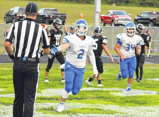 Gallia Academy senior Ben Cox (2) tosses the ball to an official after scoring a touchdown in a Week 2 football contest against River Valley in Bidwell, Ohio.
