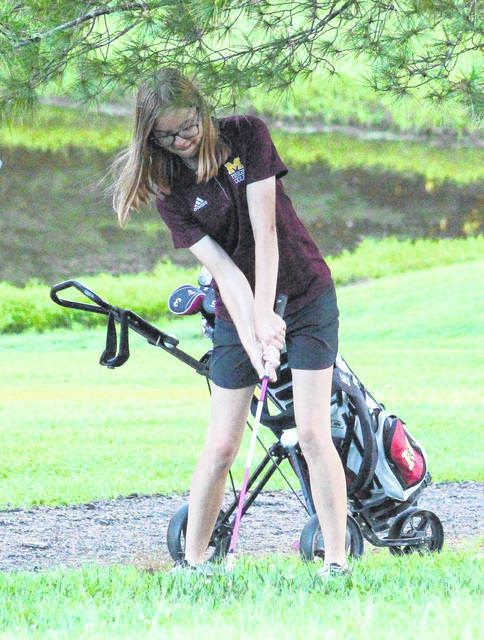 Meigs junior Caitlin Cotterill hits a chip shot during an Aug. 29 match at Meigs Golf Course in Pomeroy, Ohio.