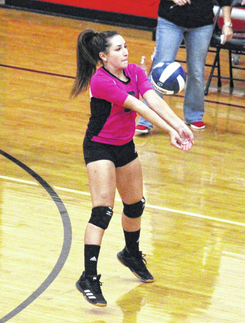 Point Pleasant sophomore Katelynn Smith bumps a ball in the air during Game 1 of Thursday night's volleyball match against Cross Lanes Christian in Point Pleasant, W.Va.