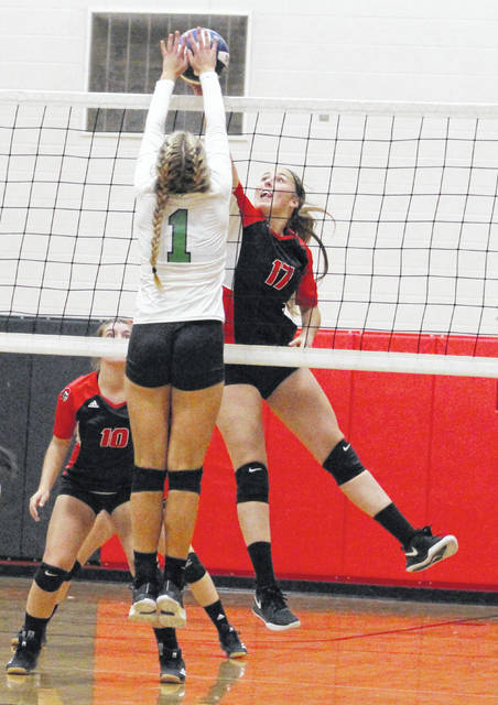 Point Pleasant senior Haley Milhoan leaps for a spike attempt during Game 2 of Thursday night's match against Winfield in Point Pleasant, W.Va.