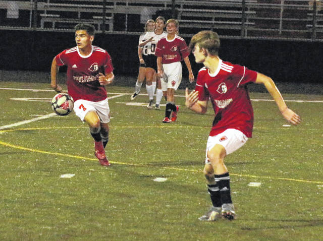 Point Pleasant junior Adam Veroski (7) surveys the field as teammate Nic Matheny, right, looks on during the second half of Thursday night's boys soccer match against Belpre at OVB Field in Point Pleasant, W.Va.