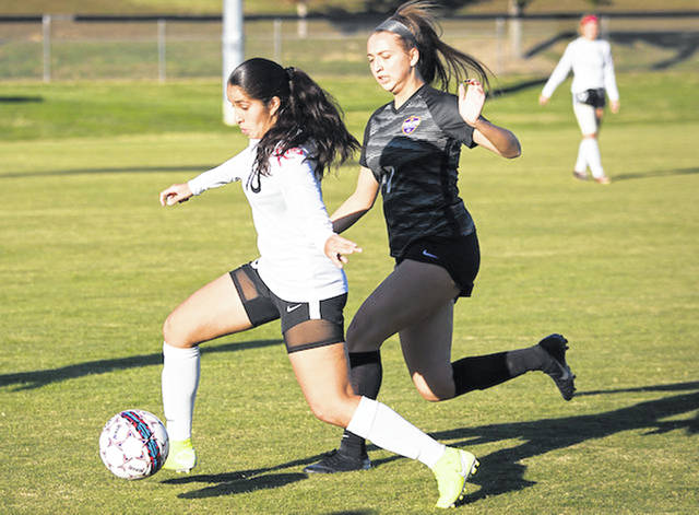Rio Grande's Ambar Torres sprints past Carlow's Natalie DiGiorno during Thursday night's River States Conference women's soccer match at Evan E. Davis Field. Torres scored both goals in the RedStorm's 2-0 win over the Celtics.